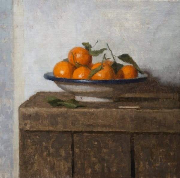 A bowl of oranges on a wooden surfaceDescription automatically generated with low confidence